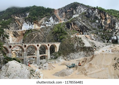 Carrara, Italy - marble quarry in Fantiscritti valley. Bridge in Miseglia. Apuan Alps mountains.