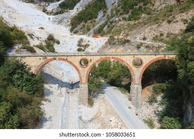 Carrara, Italy - September 25, 2015: Landscape of Carrara's marble quarry in Tuscany (Italy) with the distinctive bridge in the locality Ponti di Vara