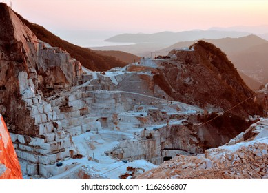 Carrara marble quarry, extraction and processing of white marble, sunset