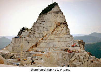 Carrara marble quarry, extraction and processing of precious white Statuario marble