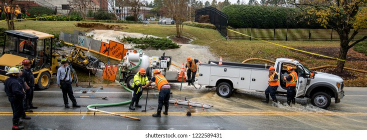 Carrboro, NC, US- November 5, 2018:  Firemen and Water Authority workers repairing a broken water main