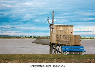 A carrelet, a traditional fishing machine, and a partial view of the gironde estuary, in meschers sur gironde, poitou, Charente-Maritime, france.