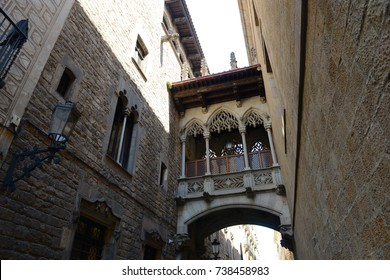 Carrer del Bisbe Irurita (Bishop Irurita's Street) and Neogothic style bridge by architect Joan Rubió in the Old City (Ciutat Vella) of Barcelona, Catalonia, Spain.