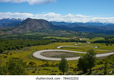 The Carretera Austral; famous road connecting remote towns and villages in northern Patagonia, Chile. Curved section running through farmland near the small town of Cerro Castillo.