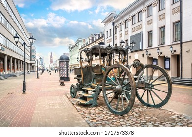 A carriage on Bauman Street in Kazan among ancient buildings and lanterns on a sunny spring day