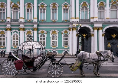 A carriage at the Palace Square outside the historical Winter Palace, St Petersburg, Russia