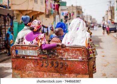 Carriage ride in St.Louis, Senegal. A family rides through town.