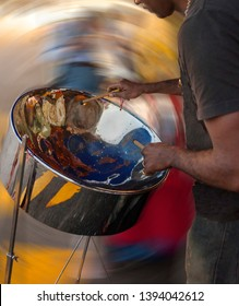 Carribean metal steel drum played by a musician
