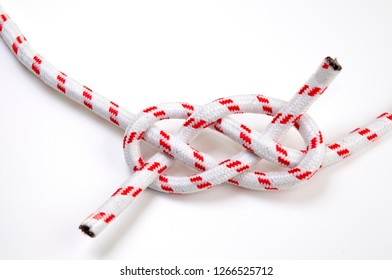 The Carrick Bend or The Josephine Knot AKA Sailor's Knot and Anchor Bend on white background Used to tie to lengths of rope together
