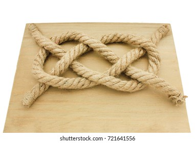 Carrick Bend Knot on wooden desk isolated on white background. Most secure waterproof option for very heavy rope or cable. Commonly used in navy training. Sailing, military, ship security concept
