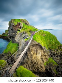 Carrick-a-Rede rope bridge in Northern Ireland. The suspended bridge built by salmon fishermen links the mainland to the tiny island of Carrickarede.