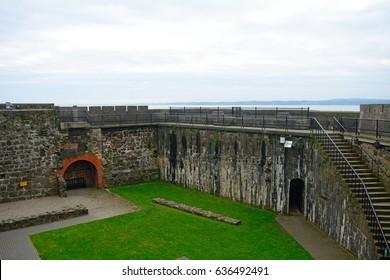 CARRICKFERGUS, NORTHERN IRELAND - APRIL 20: Castle 20 April, 2017 at Carrickfergus. Carrickfergus has a lovely medieval castle.