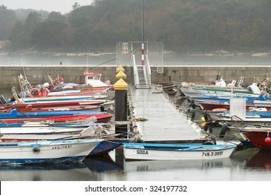 CARRIL, SPAIN, JANUARY 11, 2015: A large number of fishing boats anchored in the harbor of this village.
