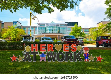 Carrollton, GA / USA - April 6, 2020: Heroes At Work Sign in Front of Tanner Medical Center Honoring the Doctors, Nurses and Medical Staff who Continue to Work Everyday During the COVID-19 Pandemic