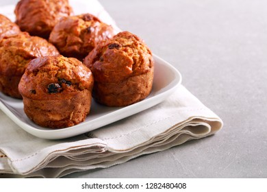 Carrot and apple muffins with raisin on plate