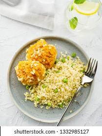 Carrot balls with bulgur and barley porridge. Vegetarian dish. Healthy food. Top view