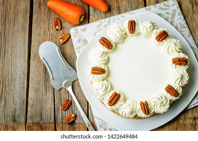 carrot cake cheesecake with pecan on a wood background. toning. selective Focus