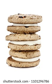 Carrot cake cookies sandwiches stuffed with cream cheese icing isolated over a white background with light shadow.