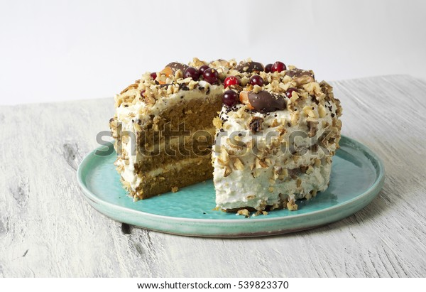Carrot cake with cream cheese, nuts, berries and tangerines
