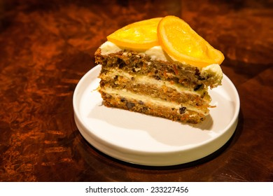 carrot cake with dried orange on it