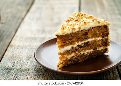 Carrot Cake With Walnuts Prunes And Dried Apricots On A Dark Wood Background Tinting
