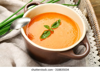 Carrot cream-soup with vegetables on table close up