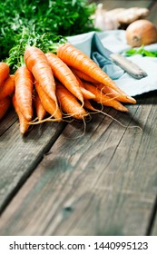 Carrot. Fresh Carrots bunch on rustic background.