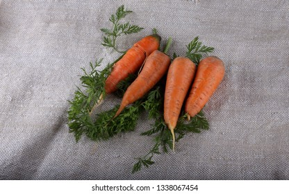 Carrot and leaves on bagging