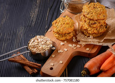 Carrot oatmeal cookies with with cranberries and cinnamon on a rustic background