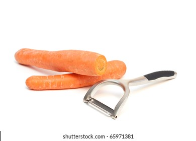 A carrot peeler and carrots isolated on a white background.
