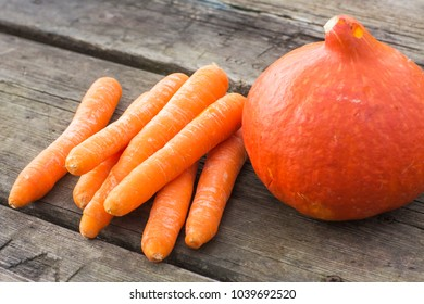 Carrot and pumpkin on wooden boards