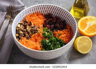 Carrot slaw with cranberries, walnuts and citrus dressing.