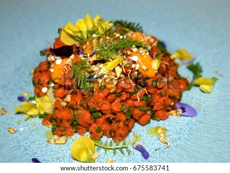 Carrot tartare decorated edible spring flowers stock photo edit now carrot tartare decorated with edible spring flowers mightylinksfo