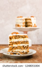 Carrot and walnut cake with cream cheese frosting. Copy space.
