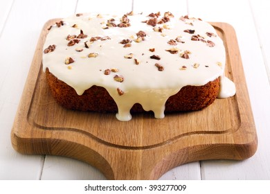 Carrot and walnut tray bake with frosting on board