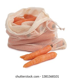 Carrots fresh out of the eco friendly bag organic cotton storage isolated on white background