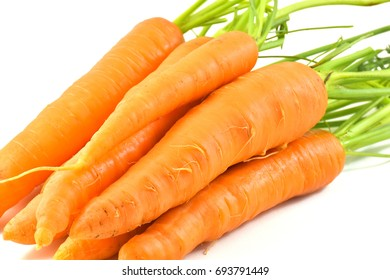 carrots isolated on white back ground, vegetable with leaves, fresh whole raw carrots, Baby carrot sticks, carrot bunch with green leaves. Healthy eating diet concept. Vegetables frame,Raw organic.