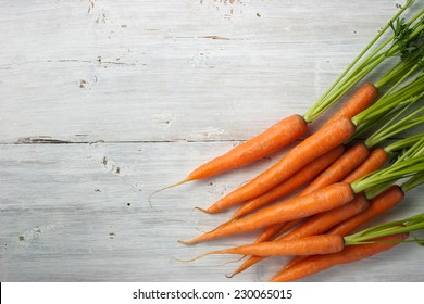 Carrots on the white wooden table horizontal