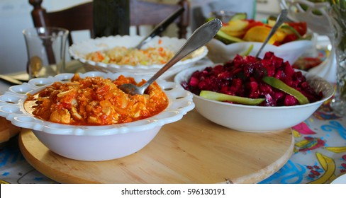 Carrots, peppers and cabbage salad and beet salad on a family table