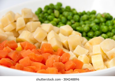 Carrots, potatoes and peas prepared for the Russian salad.