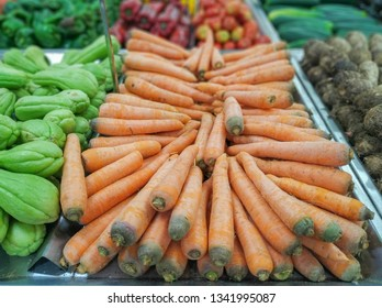 carrots for sale in supermarket in hortifruti section with blurred background