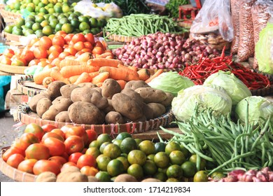carrots, tomatoes, onions, potatoes, chilies, and oranges are sold in the market with fresh conditions. Traditional market. Food needs.