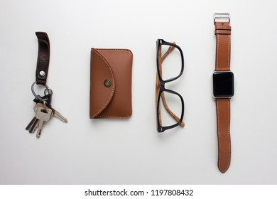 Carry objects made by brown on white background.Top view