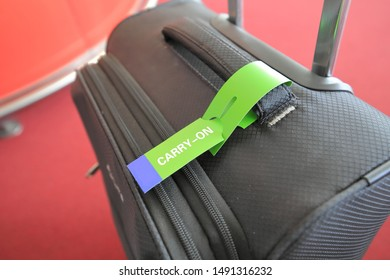 Carry on luggage tag on Suitcase