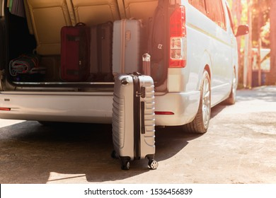 Carry-on luggage bag in mini bus travel concept.