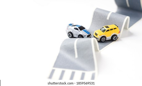 Cars accident on rough road. Two toy models on duct tape. Slippery or rough road. Insurance. Incident. Copy space