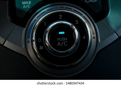 cars airconditioning and heat control dials.