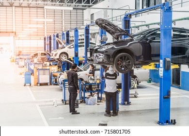 Cars are being maintained by technicians. At the Mazda service center, Thanyaburi, Pathum Thani, Thailand. 11:30 AM, 14 September 2017.