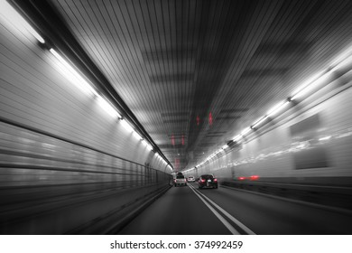 Cars in blurred tunnel