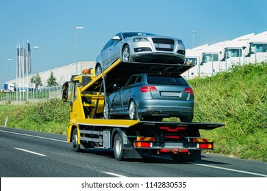 Cars carrier on the road. Truck transporter
